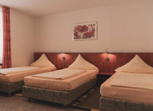 3 Bett Zimmer